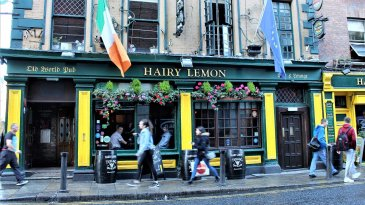 yellow exterior of hairy lemon with irish flag and a busy street