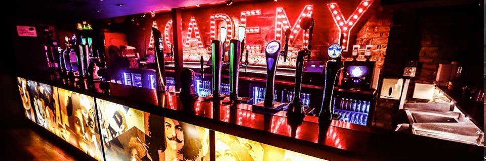 The Academy Nightclub Red Neon Lights with Beer on Tap Bar