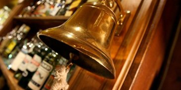 last orders bell with bar behind