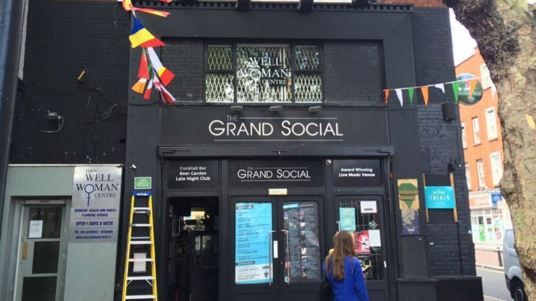 The Grand Social Black Entrance with Flags