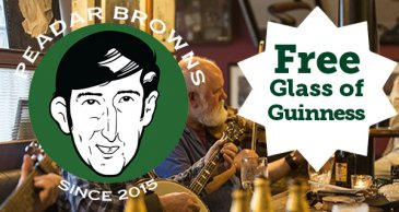 Advertisement for free offer at Peader browns pub free glass of guinness
