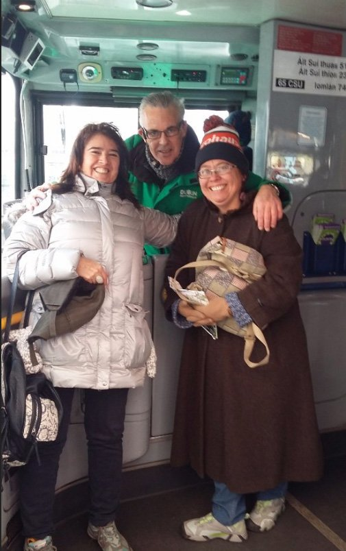 HOHO guide/driver Paddy with two satisfy customer on a DoDublin green bus