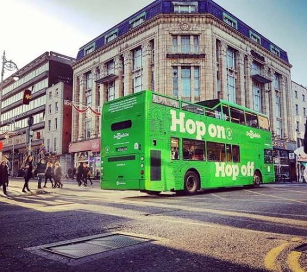Green Hop On Hop Off Tour Bus at Corner of Dame Street and Georges Street