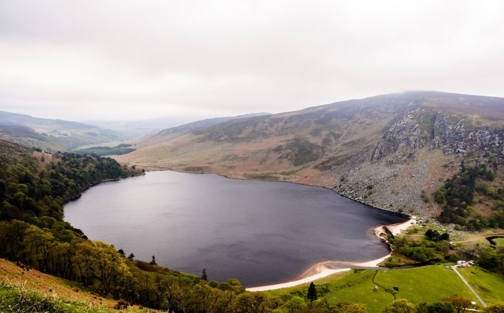 Lough Tay County Wicklow and surrounding forestry and fields.