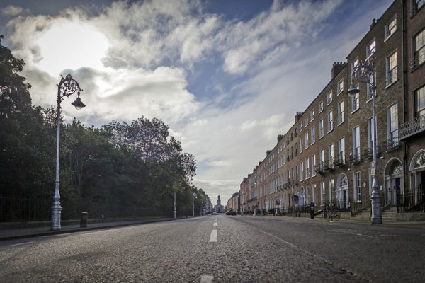 Empty Street at Merrion Square with cloudy blue sky