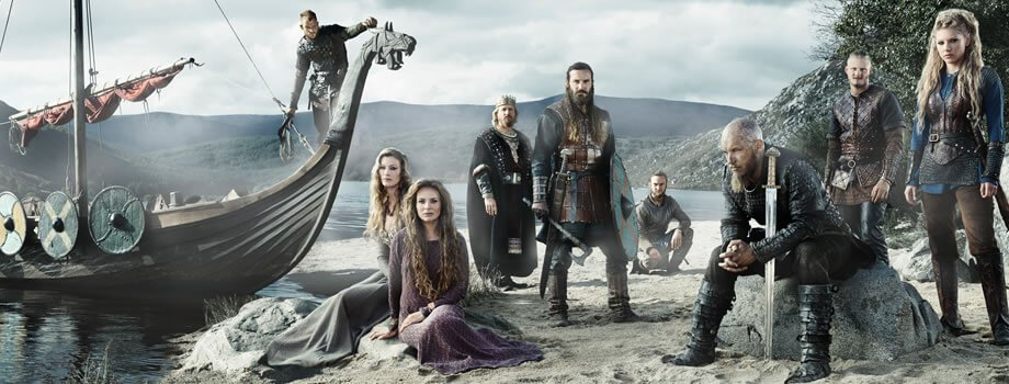 Vikings TV Cast posing alongside boat at Blessington Lakes