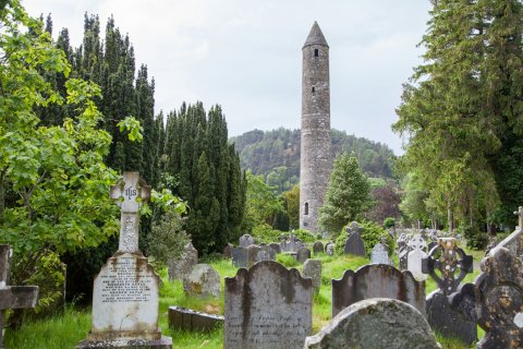 Monastic tower and graveyard in glendalough