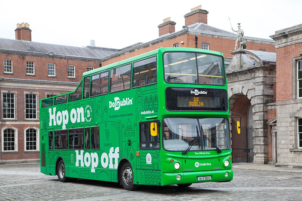 The DoDublin Green Bus tour bus outside Collins Barracks the sky is grey