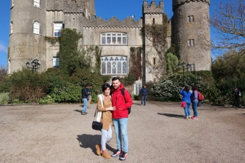 Couple posing for photo outside Malahide Castle