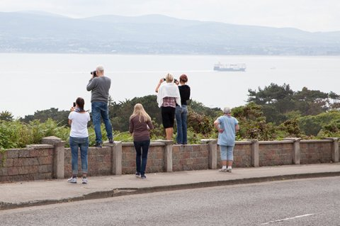 DoDublin Bus Tour Customers taking pictures from Howth Head looking towards Dublin Bay
