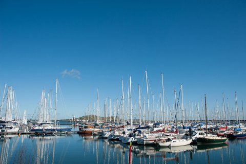 Boats moored at Howth Harbour with still waters