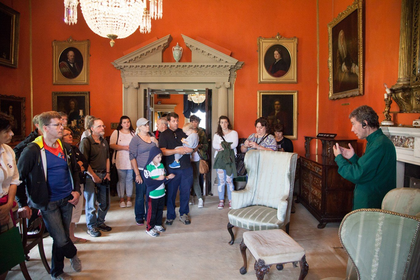 Tour guide talking to a group of visitors in a historic room in malahide castle