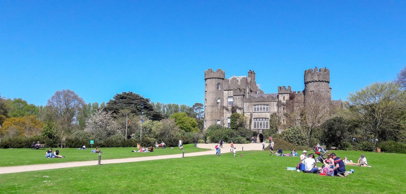 People sitting in front of Malahide Castle