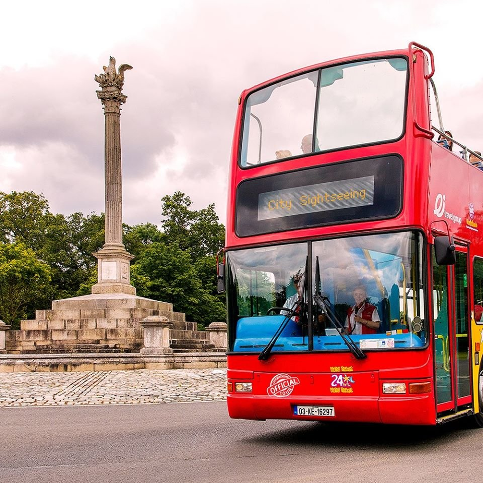 City Sightseeing Bus passing a monument in Dublin's Phoenix Park