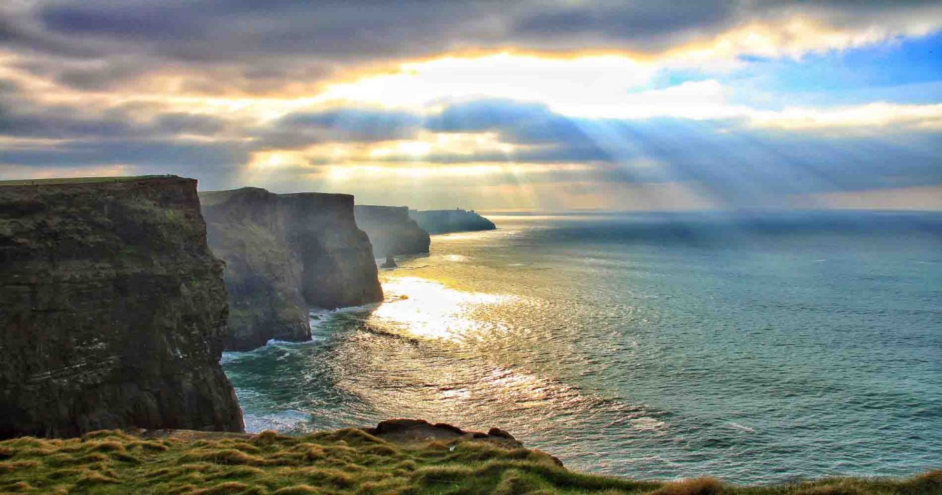 Cliffs of Moher and Atlantic Ocean with sunny sky