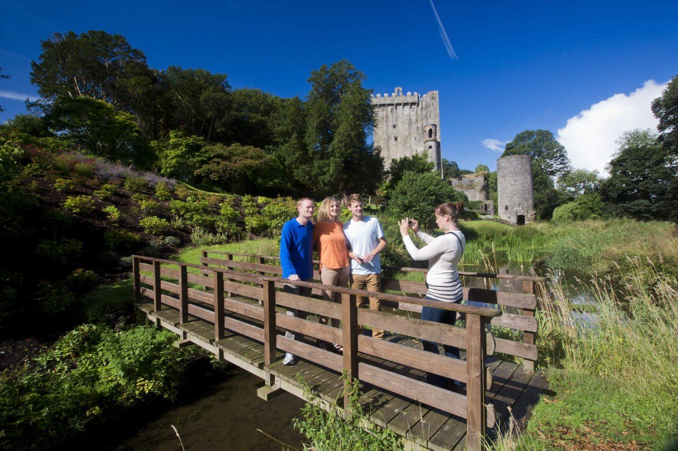 Group of friends take picture on walk around Blarney Castle & Gardens