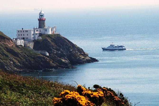 Dublin Bay Cruise boat passing lighthouse