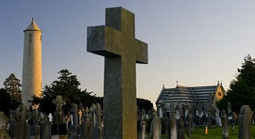Celtic Cross and O'Connell Round Tower with graves in Glasnevin Cemetery