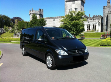 chauffeured vehicle in front of castle in ireland