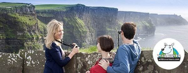 Friend enjoying the view of Cliffs of Moher on a Wild Rover Day Tour