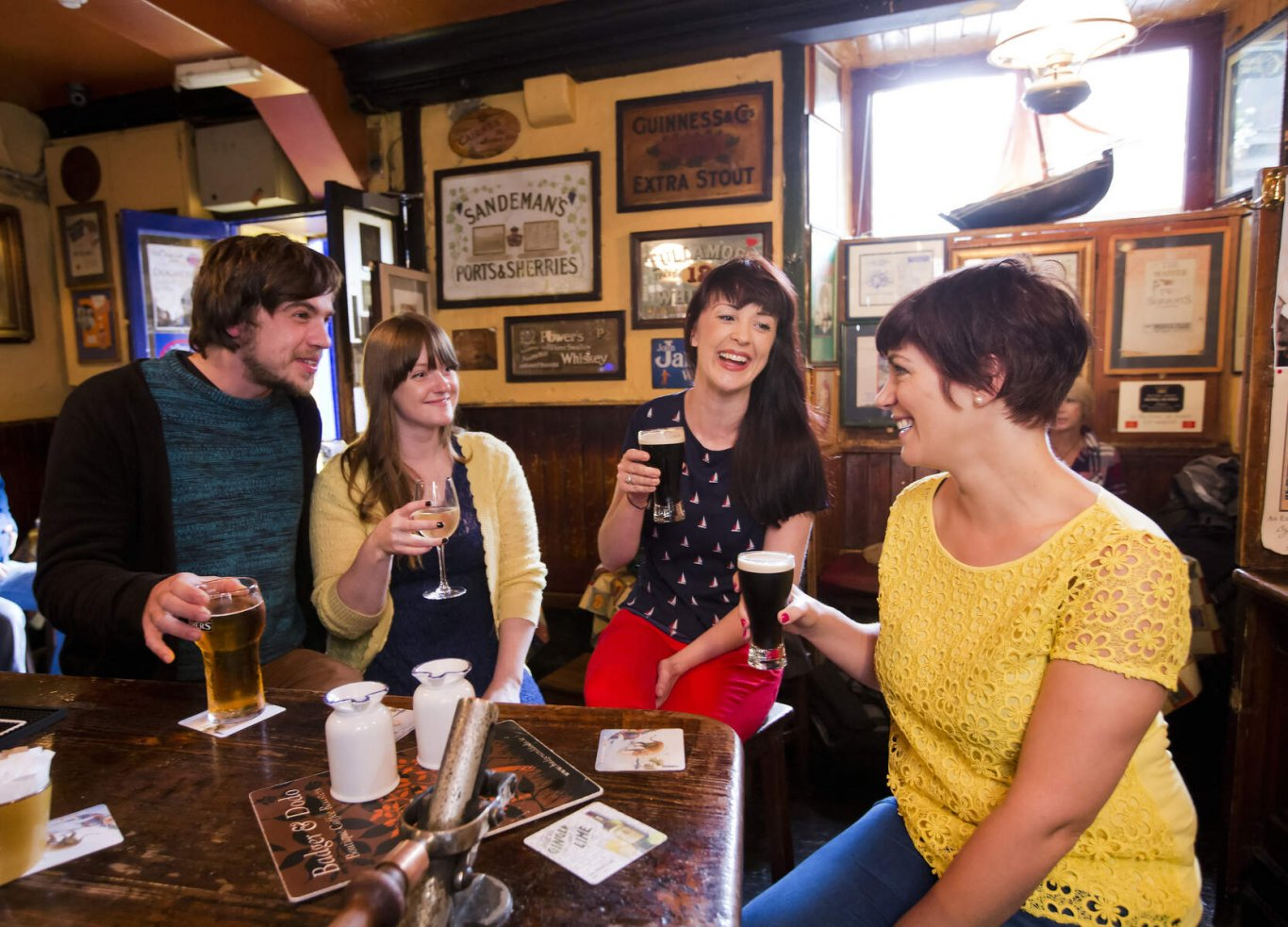 people drinking guinness in irish pub