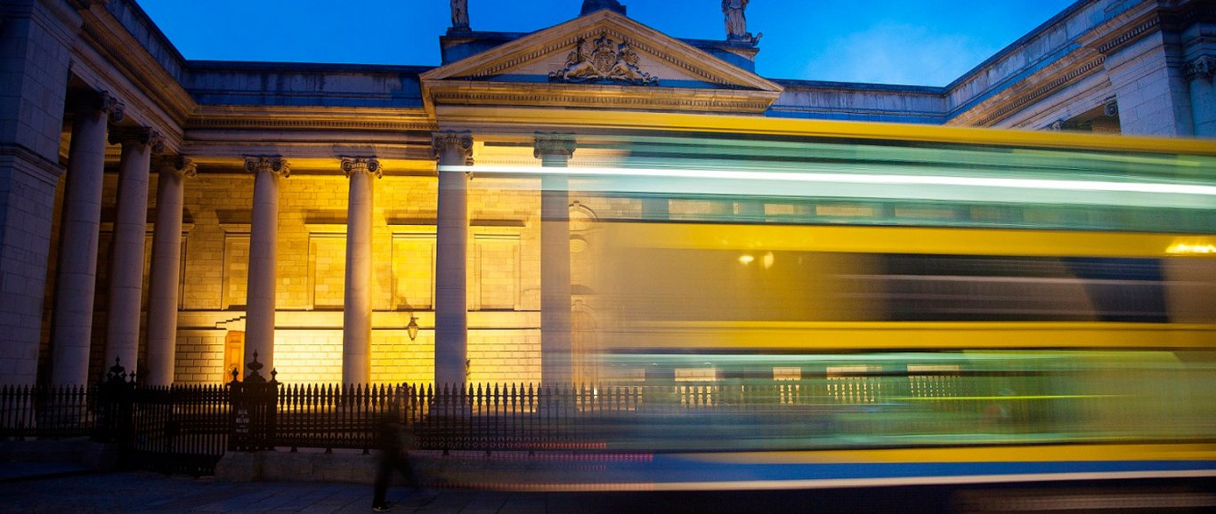 Dublin Bus at night in front of College Green